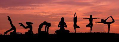 Silhouette of a beautiful Yoga woman